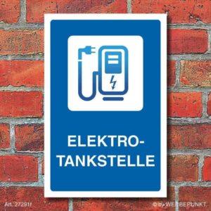 Parkplatzschild für Elektroautos an Wand geklebt